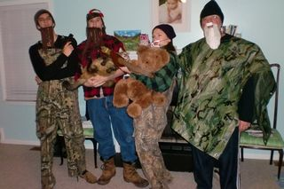 Willie, Vinny as Uncle Si with her bow and bear, and Charlie as Phil